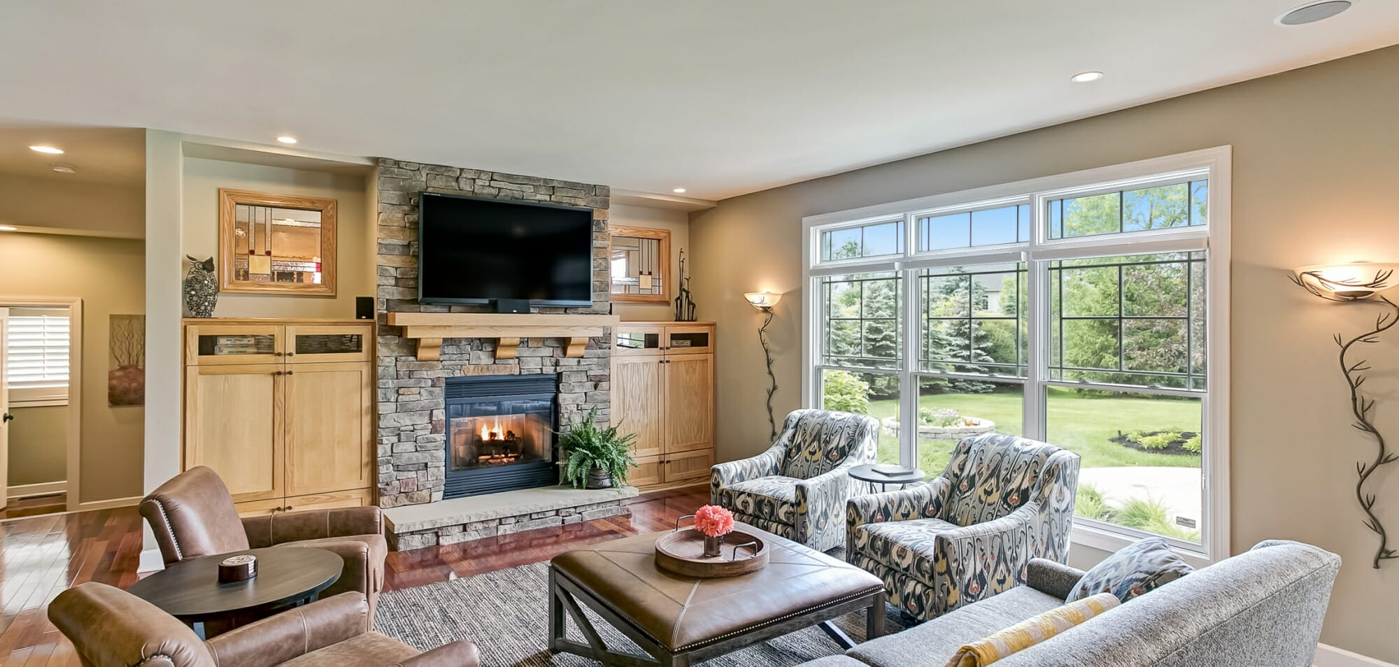 Living room with Stone fireplace custom built-ins